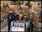 Cub Scouts sell items for charity at a Kroger charity table!