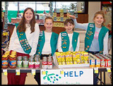 Girl Scouts sell items for charity at a Kroger charity table!